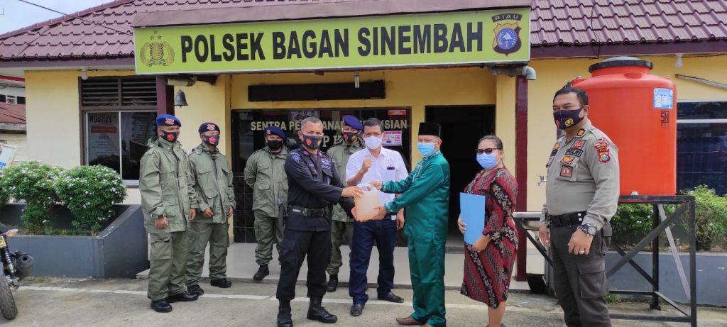 Basmi Virus Corona Pakai Mobil Water Canon, Polsek Bagan Sinembah Kampanyekan Konsistensi Penerapan Protokol Kesehatan.