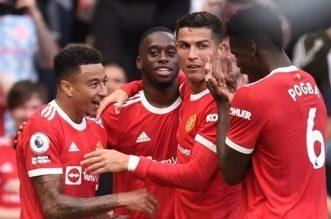 Liga Inggris, West Ham United Vs Manchester United, Dipalu The Hammer, Setan Merah Akan Kian Memerah. - Foto: Jesse Lingard merayakan gol bersama Cristiano Ronaldo dan pemain Manchester United.(AFP/Oli Scarff)
